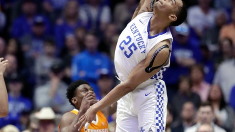 <p>               Kentucky forward PJ Washington (25) blocks a shot by Tennessee guard Admiral Schofield (5) but was called for goaltending in the second half of an NCAA college basketball game at the Southeastern Conference tournament Saturday, March 16, 2019, in Nashville, Tenn. Tennessee won 82-78. (AP Photo/Mark Humphrey)             </p>