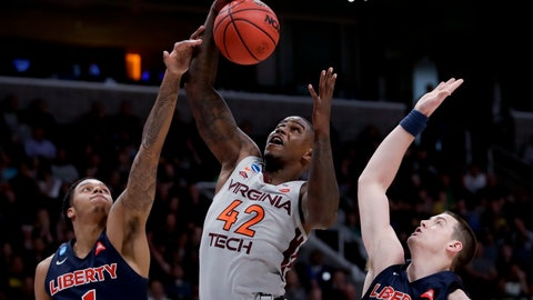 <p>               Virginia Tech guard Ty Outlaw, middle, vies for a rebound with Liberty guard Caleb Homesley, left, and Scottie James during the second half of a second-round game in the NCAA men's college basketball tournament Sunday, March 24, 2019, in San Jose, Calif. (AP Photo/Ben Margot)             </p>