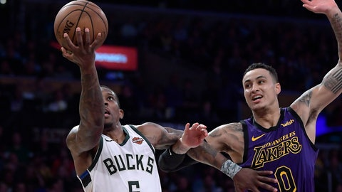 <p>               Milwaukee Bucks guard Eric Bledsoe, left, shoots as Los Angeles Lakers forward Kyle Kuzma defends during the second half of an NBA basketball game Friday, March 1, 2019, in Los Angeles. The Bucks won 131-120. (AP Photo/Mark J. Terrill)             </p>