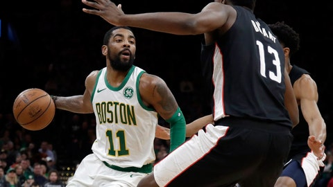 <p>               Boston Celtics guard Kyrie Irving (11) makes a move against Washington Wizards center Thomas Bryant (13) during the first quarter of an NBA basketball game Friday, March 1, 2019, in Boston. (AP Photo/Elise Amendola)             </p>