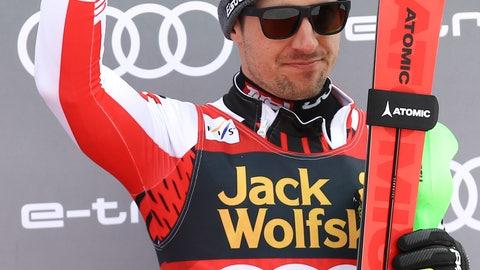 <p>               Third placed Marcel Hirscher of Austria celebrates on the podium of an Alpine Skiing World Cup men's slalom, in Kranjska Gora, Slovenia, Sunday, March. 10, 2019. (AP Photo/Marco Trovati)             </p>
