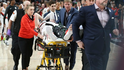 <p>               Portland Trail Blazers center Jusuf Nurkic, center, was injured and left the court on a stretcher as the Blazers beat the Brooklyn Nets in double overtime, 148-144, during an NBA basketball game in Portland, Ore., Monday, March 25, 2019. (AP Photo/Randy L. Rasmussen)             </p>