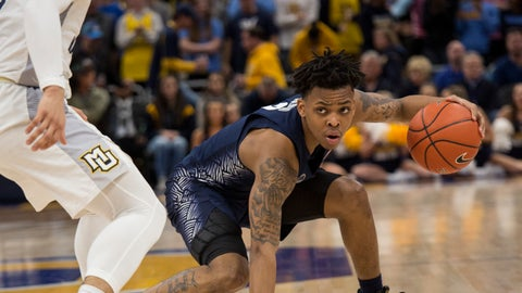 <p>               Georgetown guard James Akinjo, right, is guarded by Marquette guard Markus Howard, left, during the second half of an NCAA college basketball game Saturday, March 9, 2019, in Milwaukee. Georgetown beat Marquette 86-84. (AP Photo/Darren Hauck)             </p>