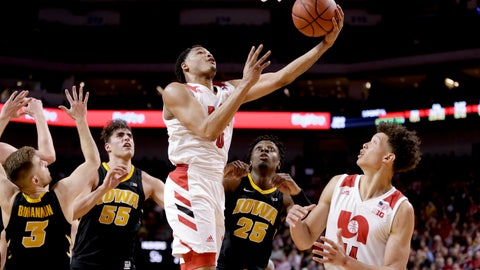 <p>               Nebraska's James Palmer Jr. (0) scores a basket with teammate Isaiah Roby (14), Iowa's Jordan Bohannon (3), Luka Garza (55) and Tyler Cook (25) watching during the second half of an NCAA college basketball game in Lincoln, Neb., Sunday, March 10, 2019. (AP Photo/Nati Harnik)             </p>