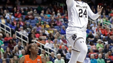 <p>               FILE- In this March 9, 2019, file photo Notre Dame's Arike Ogunbowale (24) drives to the basket past Syracuse's Gabrielle Cooper (11) during the second half of an NCAA college basketball game in the Atlantic Coast Conference tournament in Greensboro, N.C. The heroine of Notre Dame's national championship run last year, who won both Final Four and title games with dramatic, last-second shots, is ready for her last ride through the bracket, starting Saturday when the Fighting Irish takes on Bethune-Cookman in the first round. (AP Photo/Chuck Burton, File)             </p>