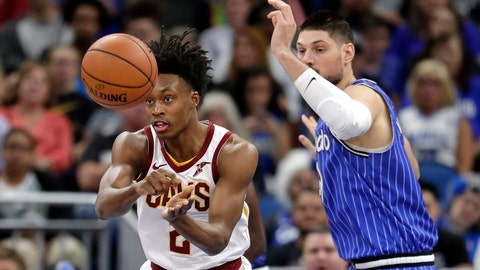 <p>               Cleveland Cavaliers' Collin Sexton, left, passes the ball around Orlando Magic's Nikola Vucevic during the first half of an NBA basketball game, Thursday, March 14, 2019, in Orlando, Fla. (AP Photo/John Raoux)             </p>