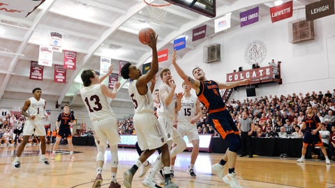 <p>               Colgate forward Malcolm Regisford (5) reaches for a rebound next to Bucknell center Nate Sestina (4) during the first half of an NCAA college basketball game for the championship of the Patriot League men's tournament in Hamilton, N.Y., Wednesday, March 13, 2019. (AP Photo/Adrian Kraus)             </p>