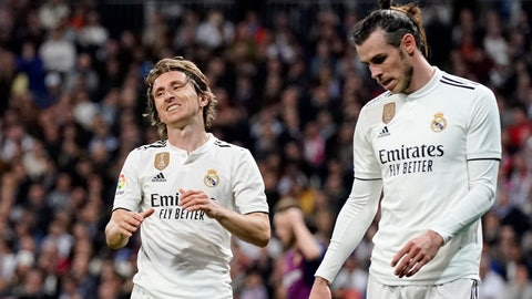<p>               Real midfielder Luka Modric, left, and Real midfielder Gareth Bale react during the Spanish La Liga soccer match between Real Madrid and FC Barcelona at the Bernabeu stadium in Madrid, Saturday, March 2, 2019. (AP Photo/Andrea Comas)             </p>