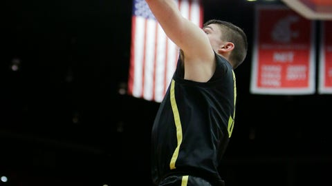 <p>               Oregon guard Payton Pritchard, center, shoots in front of Washington State forwards Robert Franks Jr., left, and Aljaz Kunc during the first half of an NCAA college basketball game in Pullman, Wash., Wednesday, March 6, 2019. (AP Photo/Young Kwak)             </p>