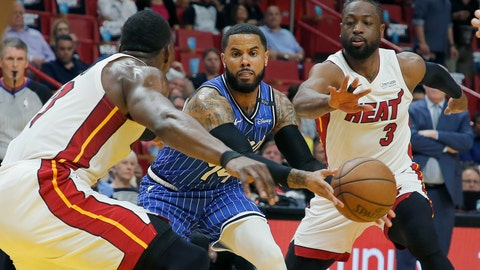 <p>               Orlando Magic guard D.J. Augustin, center, passes between Miami Heat center Bam Adebayo, left, and Dwyane Wade, right, in the first quarter during an NBA basketball game Tuesday, March 26, 2019, in Miami.(AP Photo/Joe Skipper)             </p>