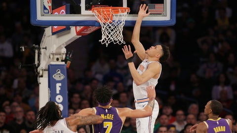 <p>               New York Knicks' Kevin Knox, top, scores during the first half of an NBA basketball game against the Los Angeles Lakers, Sunday, March 17, 2019, in New York. (AP Photo/Seth Wenig)             </p>