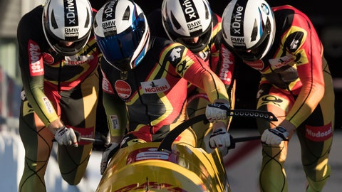 <p>               Germany's Francesco Friedrich, Candy Bauer, Martin Grothkopp and Thorsten Margis sprint from the start on their third run during the four-man  bobsled event at the Bobsleigh World Championships in Whistler, British Columbia, Saturday, March 9, 2019. (Darryl Dyck/The Canadian Press via AP)             </p>