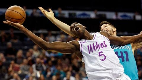 <p>               Minnesota Timberwolves center Gorgui Dieng (5), of Senegal, battles Charlotte Hornets center Willy Hernangomez for a rebound in the first half of an NBA basketball game in Charlotte, N.C., Thursday, March 21, 2019. (AP Photo/Nell Redmond)             </p>