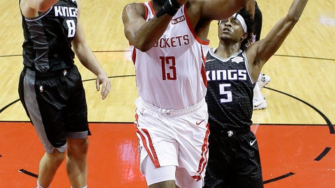 <p>               Houston Rockets guard James Harden (13) drives to the basket as Sacramento Kings guard Bogdan Bogdanovic (8) and guard De'Aaron Fox defend during the first half of an NBA basketball game, Saturday, March 30, 2019, in Houston. (AP Photo/Eric Christian Smith)             </p>