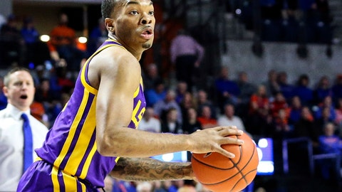 <p>               FILE - In this Wednesday, March 6, 2019, file photo, LSU guard Javonte Smart (1) looks for an outlet during the first half of an NCAA college basketball game against Florida in Gainesville, Fla. Smart will play for in the Southeastern Conference Tournament after missing the Tigers' regular-season finale because his name surfaced in reports of a wiretapped phone call that resulted in coach Will Wade's suspension. (AP Photo/Gary McCullough, File)             </p>