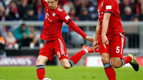 <p>               Bayern's Robert Lewandowski, left, kicks the ball during the German Bundesliga soccer match between FC Bayern Munich and VfL Wolfsburg in Munich, Germany, Saturday, March 9, 2019. Robert Lewandowski has become the outright top-scoring foreign player in Bundesliga history. (AP Photo/Matthias Schrader)             </p>