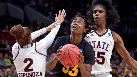 <p>               Arizona State center Charnea Johnson-Chapman, center, shoots between Mississippi State guard Andra Espinoza-Hunter, left, and center Teaira McCowan during the first half of a regional semifinal in the NCAA women's college basketball tournament Friday, March 29, 2019, in Portland, Ore. (AP Photo/Craig Mitchelldyer)             </p>
