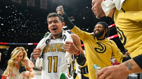 <p>               Atlanta Hawks guard Trae Young (11) is doused by forward DeAndre' Bembry as they and Justin Anderson, right, celebrate after Young's winning basket against the Philadelphia 76ers in an NBA basketball game Saturday, March 23, 2019, in Atlanta. (AP Photo/John Amis)             </p>