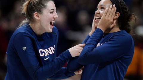 <p>               Connecticut seniors Katie Lou Samuelson, left, and Napheesa Collier share a light moment as their numbers are revealed on the Huskies of Honor wall during an NCAA college basketball game against Houston, Saturday, March 2, 2019, in Storrs, Conn. (AP Photo/Jessica Hill)             </p>