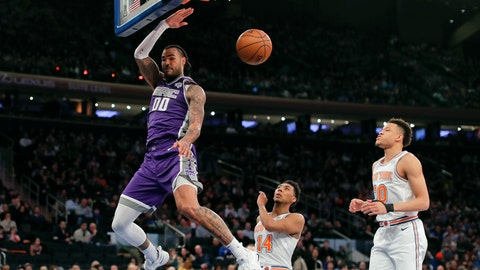 <p>               Sacramento Kings center Willie Cauley-Stein (00) dunks the ball ahead of New York Knicks guard Allonzo Trier (14) and forward Kevin Knox (20) during the second quarter of an NBA basketball game, Saturday, March 9, 2019, in New York. (AP Photo/Julie Jacobson)             </p>