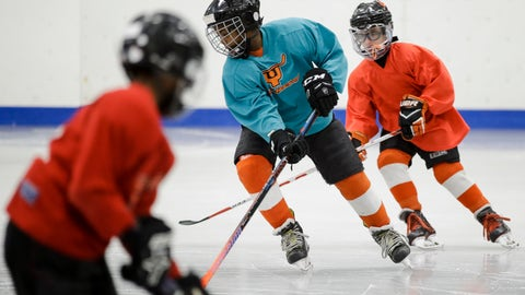 <p>               In this Feb. 21, 2019 photo Malakye Johnson takes part in a Snider Hockey practice at the Scanlon Ice Rink in Philadelphia. (AP Photo/Matt Rourke)             </p>