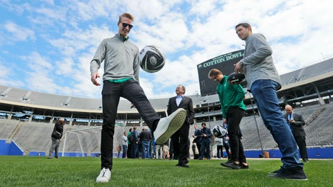 <p>               Dallas Stars' John Klingberg, left, plays with a soccer ball as Stars goaltender Ben Bishop, right, Miro Heiskanen, center right, and NHL commissioner Gary Bettman look on while touring the playing field of the Cotton Bowl in Dallas, Wednesday, March 20, 2019. The players and commissioner were on hand to announce the NHL Winter Classic hockey game between the Nashville Predators and the Dallas Stars to be played Jan. 1, 2020, at the Cotton Bowl in Dallas. (AP Photo/LM Otero)             </p>