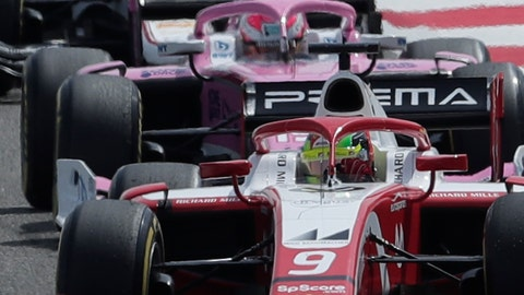 <p>               Mick Schumacher, foreground, steers his Prema Racing car during the Formula 2 Grand Prix at the Formula One Bahrain International Circuit in Sakhir, Bahrain, Saturday, March 30, 2019. (AP Photo/Hassan Ammar)             </p>