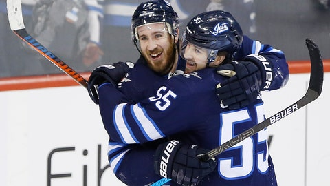 <p>               Winnipeg Jets' Kevin Hayes (12) and Mark Scheifele (55) celebrate Hayes' his first goal for the Jets since his recent trade to the team, against the Nashville Predators during the third period of an NHL hockey game Friday, March 1, 2019, in Winnipeg, Manitoba. (John Woods/The Canadian Press via AP)             </p>