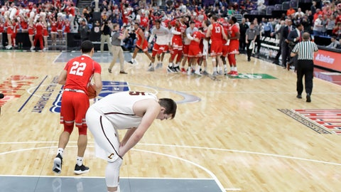 <p>               Loyola of Chicago's Cameron Krutwig bends over in the foreground as members of Bradley celebrate their victory in the background following an NCAA college basketball game in the semifinal round of the Missouri Valley Conference tournament, Saturday, March 9, 2019, in St. Louis. (AP Photo/Jeff Roberson)             </p>