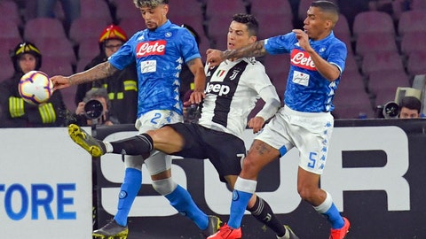 <p>               Juventus' Cristiano Ronaldo, center, struggles for the ball with Napoli's Kevin Malcuit, left,  and Napoli's Allan during the Serie A soccer match between Napoli and Juventus, at the San Paolo stadium in Naples, Italy, Sunday, March 3, 2019. (Ciro Fusco/ANSA via AP)             </p>