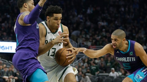 <p>               Milwaukee Bucks' Malcolm Brogdon (13) drives between Charlotte Hornets' Miles Bridges and Nicolas Batum (5) during the second half of an NBA basketball game Saturday, March 9, 2019, in Milwaukee. The Bucks won, 131-114. (AP Photo/Aaron Gash)             </p>