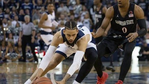 <p>               Nevada forward Cody Martin (11) beats San Diego State guard Devin Watson (0) to a loose ball in the first half of an NCAA college basketball game in Reno, Nev., Saturday, March 9, 2019. (AP Photo/Tom R. Smedes)             </p>