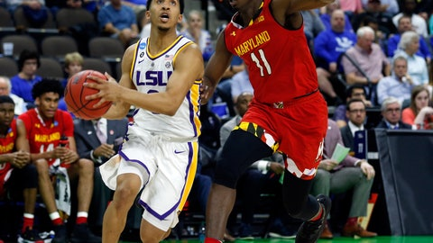 <p>               LSU's Tremont Waters, left, goes to the basket past Maryland's Darryl Morsell (11) during the first half of a second-round game in the NCAA men's college basketball tournament in Jacksonville, Fla., Saturday, March 23, 2019. (AP Photo/Stephen B. Morton)             </p>