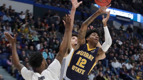 <p>               Murray State's Ja Morant (12) passes the ball under pressure from Marquette's Sacar Anim (2) and Brendan Bailey, behind, during the first half of a first round men's college basketball game in the NCAA Tournament, Thursday, March 21, 2019, in Hartford, Conn. (AP Photo/Elise Amendola)             </p>