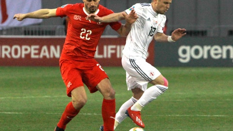 <p>               Switzerland's Fabian Schar, left, and Georgia's Jano Ananidze challenge for the ball during the Euro 2020 group D qualifying soccer match between Georgia and Switzerland at Boris Paichadze Erovnuli stadium in Tbilisi, Georgia, Saturday, March 23, 2019. (AP Photo/Shakh Aivazov)             </p>