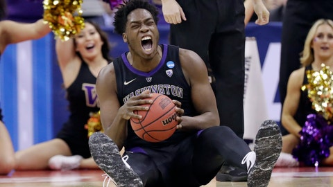 <p>               Washington's Noah Dickerson (15) reacts after getting possession of the ball against Utah State in the first half during a first round men's college basketball game in the NCAA Tournament in Columbus, Ohio, Friday, March 22, 2019. (AP Photo/Tony Dejak)             </p>