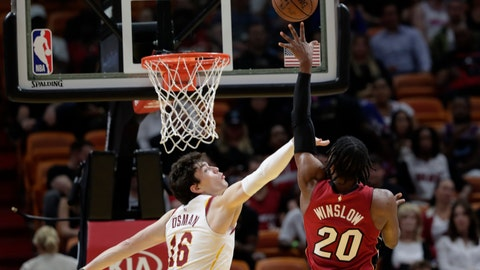 <p>               Miami Heat forward Justise Winslow (20) shoots as Cleveland Cavaliers forward Cedi Osman (16) defends during the first half of an NBA basketball game, Friday, March 8, 2019, in Miami. (AP Photo/Lynne Sladky)             </p>
