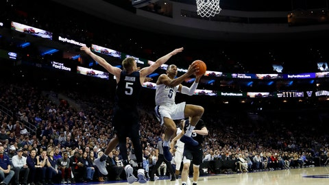 <p>               Villanova's Phil Booth, center, goes up for shot against Butler's Paul Jorgensen during the first half of an NCAA college basketball game, Saturday, March 2, 2019, in Philadelphia. (AP Photo/Matt Slocum)             </p>
