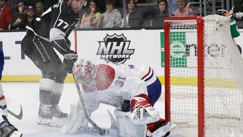 <p>               Montreal Canadiens goaltender Carey Price, right, stop a shot from Los Angeles Kings' Jeff Carter (77) during the second period of an NHL hockey game Tuesday, March 5, 2019, in Los Angeles. (AP Photo/Marcio Jose Sanchez)             </p>