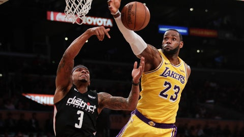 <p>               Los Angeles Lakers' LeBron James, right, grabs a rebound against Washington Wizards' Bradley Beal during the first half of an NBA basketball game, Tuesday, March 26, 2019, in Los Angeles. (AP Photo/Jae C. Hong)             </p>