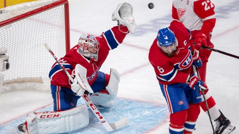 <p>               Montreal Canadiens goaltender Carey Price (31) makes a save as Detroit Red Wings center Michael Rasmussen (27) and Montreal Canadiens defenseman Shea Weber (6) watch during the second period of an NHL hockey game Tuesday, March 12, 2019, in Montreal. (Ryan Remiorz/The Canadian Press via AP)             </p>