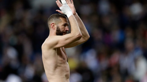 <p>               Real Madrid's Karim Benzema applauds the fans at the end of a Spanish La Liga soccer match between Real Madrid and Huesca at the Santiago Bernabeu stadium in Madrid, Sunday, March 31, 2019. Benzema scored the third goal in Real Madrid's 3-2 win. (AP Photo/Bernat Armangue)             </p>