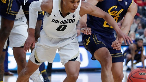 <p>               Colorado's Shane Gatling (0) and California's Matt Bradley vie for the ball during the first half of an NCAA college basketball game in the first round of the Pac-12 men's tournament Wednesday, March 13, 2019, in Las Vegas. (AP Photo/John Locher)             </p>