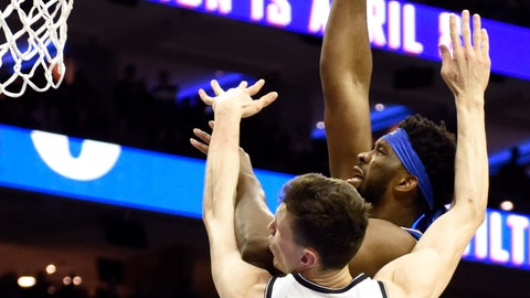 <p>               Philadelphia 76ers' Joel Embiid, right, shoots over Brooklyn Nets' Rodions Kurucs, left, during the first half of an NBA basketball game, Thursday, March 28, 2019, in Philadelphia. (AP Photo/Michael Perez)             </p>