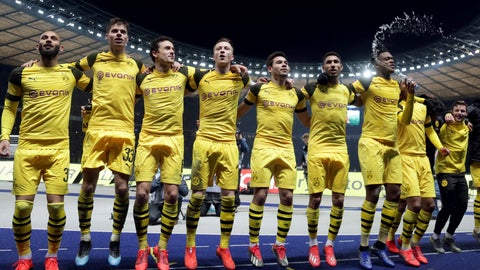 <p>               Dortmund's players celebrate in front of their supporters after the German Bundesliga soccer match between Hertha BSC Berlin and Borussia Dortmund in Berlin, Germany, Saturday, March 16, 2019. Dortmund defeated Berlin by 3-2. (AP Photo/Michael Sohn)             </p>