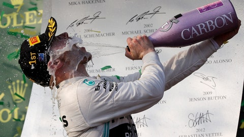 <p>               Mercedes driver Valtteri Bottas of Finland sprays himself with champagne after winning the Australian Formula 1 Grand Prix in Melbourne, Australia, Sunday, March 17, 2019. Bottas won ahead of teammate Lewis Hamilton of Britain while Red Bull driver Max Verstappen of the Netherlands placed third.(AP Photo/Rick Rycroft)             </p>