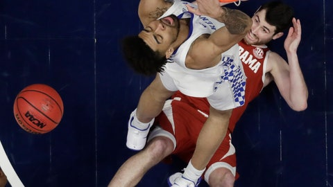 <p>               Alabama guard Riley Norris watches from the floor as Kentucky forward Nick Richards dunks the ball above him in the first half of an NCAA college basketball game at the Southeastern Conference tournament Friday, March 15, 2019, in Nashville, Tenn. (AP Photo/Mark Humphrey)             </p>