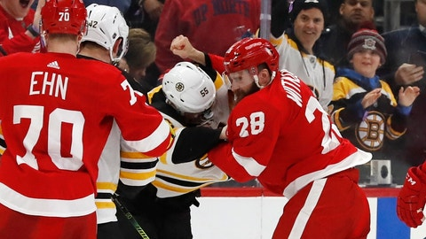 <p>               Boston Bruins center Noel Acciari (55) and Detroit Red Wings right wing Luke Witkowski (28) fight during the second period of an NHL hockey game, Sunday, March 31, 2019, in Detroit. (AP Photo/Carlos Osorio)             </p>