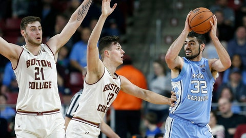 <p>               Boston College's Nik Popovic (21) and Luka Kraljevic (13) defend against North Carolina's Luke Maye (32) during the first half of an NCAA college basketball game in Boston, Tuesday, March 5, 2019. (AP Photo/Michael Dwyer)             </p>