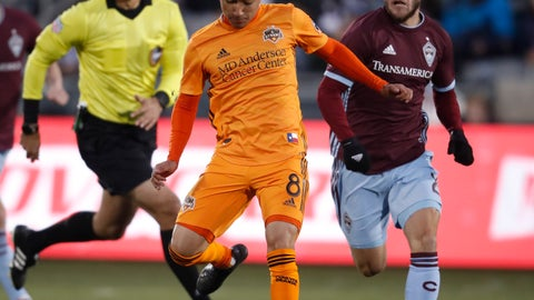 <p>               Houston Dynamo midfielder Memo Rodriguez, center, passes the ball as Colorado Rapids defender Keegan Rosenberry, right, pursues in the first half of a MLS soccer match Saturday, March 30, 2019, in Commerce City, Colo. (AP Photo/David Zalubowski)             </p>